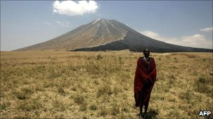 A Massai tribesman stands on the slopes leading up to the Ol Doinyo Lengai volcano