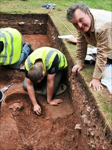 Professor Mark Horton watches as a skeleton is excavated