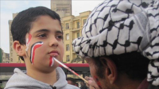 Boy having his face painted in Tahrir Square