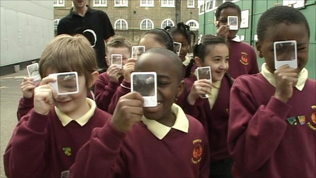 Children holding up magnifying glasses
