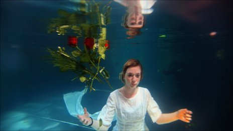 Helen Morton of the Three Bugs Fringe Theatre company performs Ophelia drowning in the Apex Hotel swimming pool