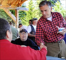 Jon Huntsman shakes hands at a cultural festival in New Hampshire