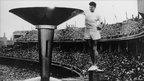 Ron Clarke of Australia lights the Olympic torch at the opening ceremony Melbourne 1956 Games