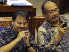 Indonesian members of parliament on their smartphones