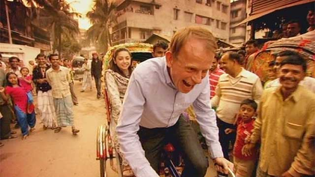 Andrew Marr driving a rickshaw
