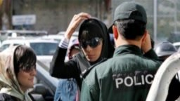 Iranian woman in front of a police officer