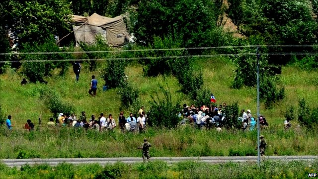 Syrian refugees waiting to cross over into Turkey, 8 June 2011