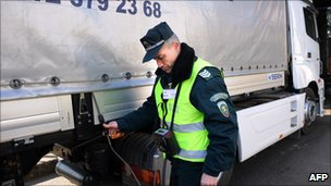 Bulgarian customs officer checks lorry on Bulgaria-Turkey border - file pic