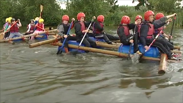 Group of children rafting