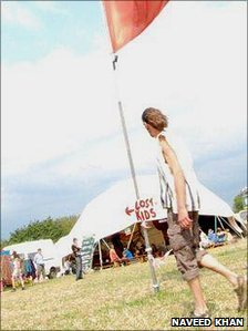 A tall hippy looks for the lost kids tent at the Sunrise Celebration