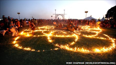 Festival-goers play with fire at the Sunrise Celebration
