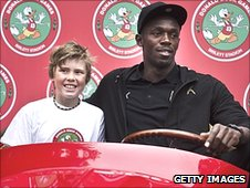Jan Marcus Solheim rides in Donald Duck's car with Usain Bolt