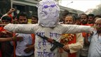 Hindu nationalists point a toy gun at an effigy of MF Hussain during a protest in Delhi in February 2006