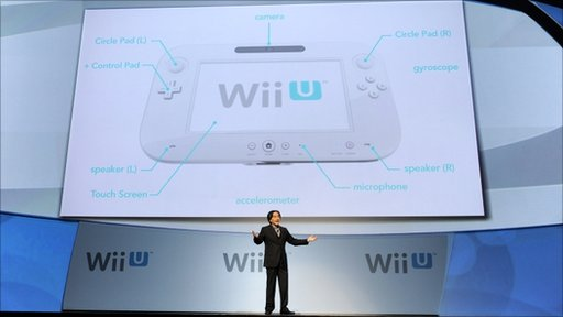 Satoru Iwata, President of Nintendo Co., Ltd., discusses their new gaming console the Wii U during a news conference at the E3 Gaming Convention
