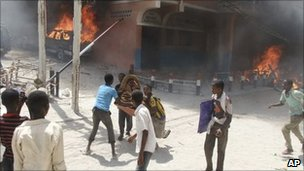 Protesters set fires outside the Medina hotel which accommodates Somali MPs on 10 June, amid on-going political turmoil in the country,
