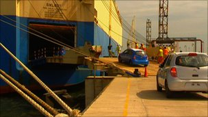 Nissan Micra cars being driven on to a Korean freighter at Ennore port