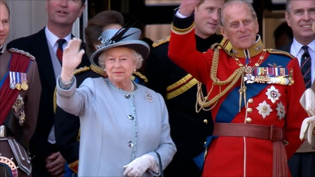 The Queen and Duke of Edinburgh wave to crowds