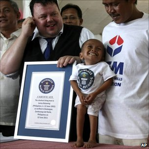 Junrey Balawing is presented with the Guinness World Records certificate declaring him the world&#039;s shortest man - 12 June 2011