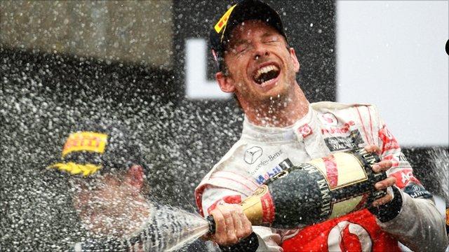 Jenson Button celebrates winning the Canadian Grand Prix