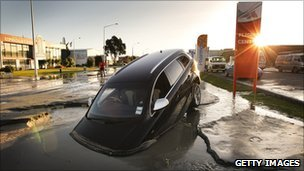 A car stands in water on Ferry Road after two magnitude 6.0 and 5.5 earthquakes struck on June 13, 2011 in Christchurch, New Zealand
