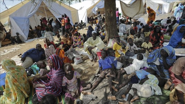 Residents gather outside the UNMIS sector headquarters after fleeing fighting in Kadugli, the capital of South Kordofan, Sudan, Thursday, June 9, 2011.
