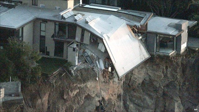 Quake-damaged cliff-top house
