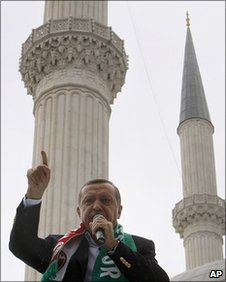 Turkish PM Recep Tayyip Erdogan campaigning in front of a mosque