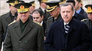 Turkish Prime Minister Recep Tayyip Erdogan walks with the army chief of staff, General Ilker Basbug