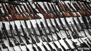 Seized weapons are displayed to the media by the Mexican Navy in Mexico City 9 June, 2011