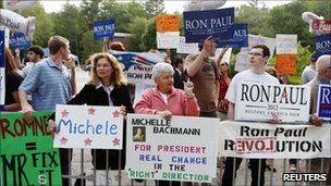 Supporters of Republican presidential hopefuls demonstrate in Manchester, New Hampshire, 13 June 2011.