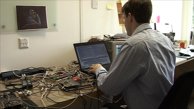Man operating computer equipment