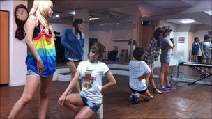 South Korean girl band Rainbow rehearse at a studio in Seoul