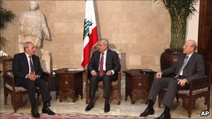 Lebanese President Michel Suleiman, centre, meets new Prime Minister Najib Mikati, right, and parliament Speaker Nabih Berri, left, before announcing the new cabinet, at the Presidential Palace in Baabda, east of Beirut, Lebanon