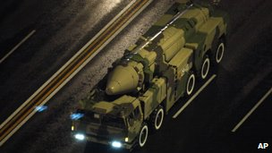 Chinese military vehicle carrying a DF21 medium range ballistic missile is on its way to a military parade rehearsal for the 60th anniversary of the founding of the People&#039;s Republic held in Beijing, China, September 6, 2009