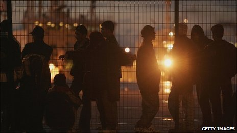 Migrants in Calais await a chance to stowaway into Britain