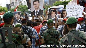 Posters supporting Syrian President Bashar al-Assad at a rally in Beirut