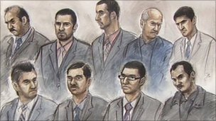 Court artist's drawing of the nine defendants