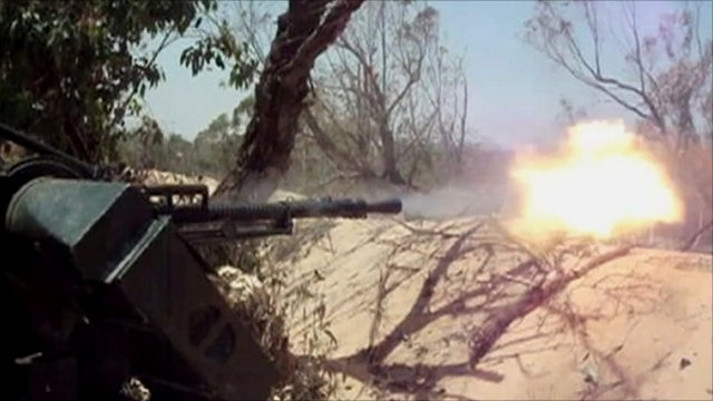Rebel gun fire in Libya