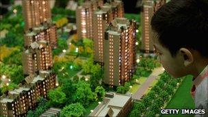 Consumer looking at property model