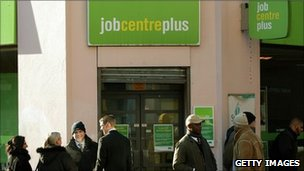 People queue outside a Job Centre Plus branch