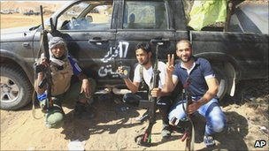 Rebel fighters pose for a picture at the front line of Dafniya about 25 miles (40km) west of Misrata, Libya