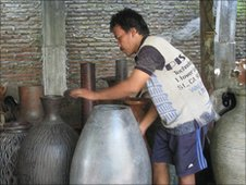 Ginaryo a ceramicist with the pots in his workshop