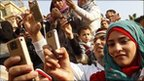 Egyptians use their mobile phone to record celebrations in Cairo's Tahrir Square in February after Hosni Mubarak resigned