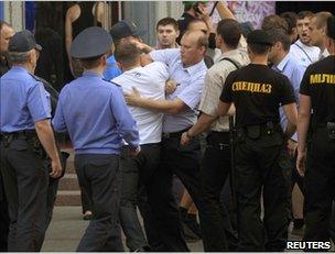 Police detain a man in Minsk, 15 June