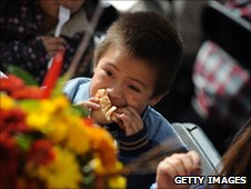 A young boy enjoys a lunch at the Los Angeles Mission and Anne Douglas Center's Thanksgiving meal for the homeless