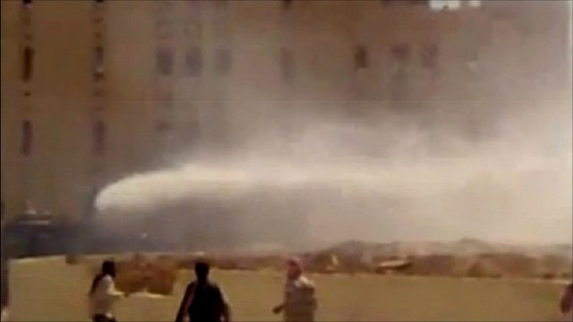 Unverified footage said to show protesters targetting snipers with water cannons in Hama