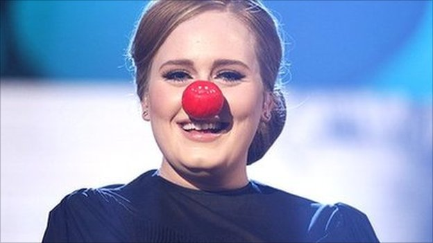 Adele wearing a red nose