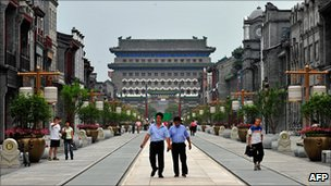 Visitors walk down the once historical Qianmen Street in one of Beijing&#039;s oldest neighbourhoods which has now been turned into a tourist attraction 