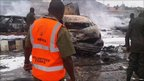 A Nema official looks at a vehicle believed to be the one in which the explosion was planted
