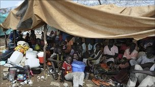 Photo handout from UNMIS of refugees sheltering outside UN sector headquarters after fleeing fighting in Kadugli, the capital of South Kordofan, Sudan (June 9, 2011)